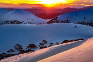 Karl Gray Gallery - The sun setting over Mt Buffalo through the razorback saddle - 107